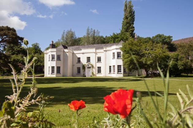 The gardens outside Tall John's Weddings, Powys