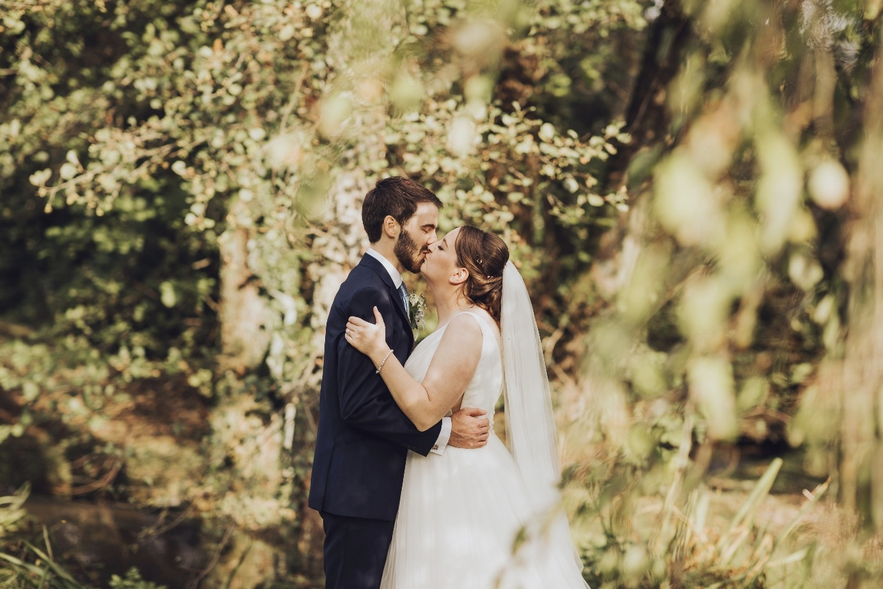 Couple kiss in the woods